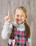 Girl shows his index finger upwards Stock Image