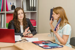 Girl shows HR specialist diplomas which she does not want to look Stock Photos