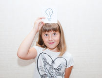 Girl shows idea message card. Little girl show in right hand card with idea sign Stock Image