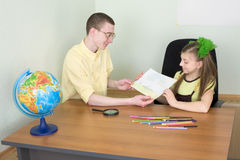 Girl shows new drawing to the brother Royalty Free Stock Photography