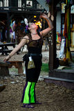Fire Eater Girl. A girl shows off her fire eating skills during The Sherwood Forest Faire on March 31, 2013 Royalty Free Stock Photo