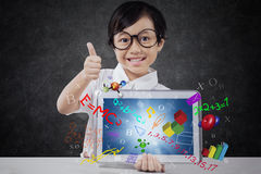 Girl shows OK sign with tablet and formula Stock Photography