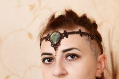 The girl shows ornaments from macrame. Diadem Stock Image
