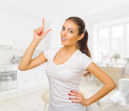 Girl shows pointing gesture Stock Photo