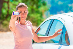 Girl shows rental car Keychain. Beautiful girl shows rental car Keychain Stock Photos