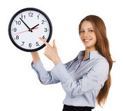 Girl shows on the round clock Royalty Free Stock Photo