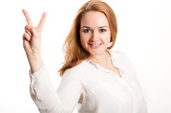Girl shows a sign on the fingers Royalty Free Stock Image