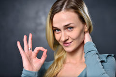 Girl shows a sign with his hands that everything will be fine.  Stock Photo