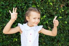 A girl shows a signs of excellent and OK Stock Images