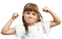 The girl shows that she is strong Stock Images