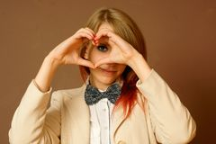 Girl shows a symbol of love Stock Photography