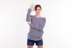 Girl shows symbols fingers Royalty Free Stock Image
