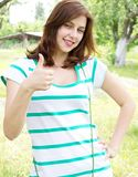 Girl shows the thumb. Cute girl shows the thumb as a sign that all is well Stock Photography