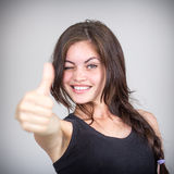 Girl shows the thumb and winks Royalty Free Stock Photography
