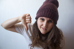 Girl shows a thumbs down Stock Image