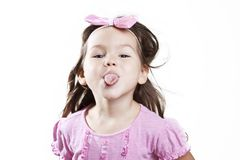 Girl shows tongue Stock Images