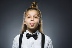 Girl shows tongue. mischievous human emotion facial expression body language Stock Images