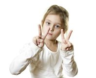 Girl  shows two fingers. Cute little girl with blue eyes shows two fingers Royalty Free Stock Photography
