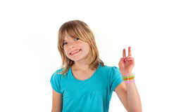 Girl shows victory sign Stock Images