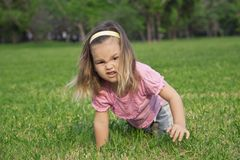 Girl shows a wild animal in the park Stock Photos