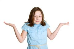 Girl Shrugging. Pretty isolated young girl shrugging royalty free stock photos