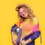 Girl in shutter glasses holding disco ball Stock Images