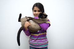 Girl with siamese cat Royalty Free Stock Images