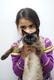 Girl with siamese cat Stock Photo