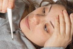 Girl sick in bed Royalty Free Stock Image
