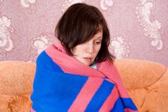 Girl is sick at home Royalty Free Stock Photo