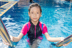 Girl side of swimming pool Stock Photo
