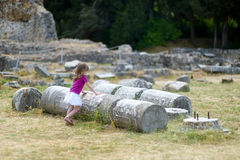A girl sightseeing historical ruins of Asclepieion Royalty Free Stock Images