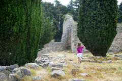 A girl sightseeing historical ruins of Asclepieion Stock Photography