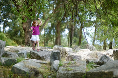 A girl sightseeing historical ruins of Asclepieion Stock Photos