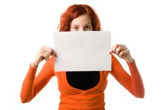 Girl with sign. Red haired woman with an empty sign Royalty Free Stock Image