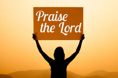 Girl with a sign with word praise the lord Stock Photography