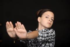 Girl signaling to stop Stock Photos