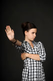 Girl signaling to stop Stock Photo