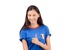 Girl signing thumbs up for France. Stock Photos