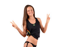 Girl signing victory for Brazil. Stock Photo