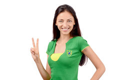 Girl signing victory for Brazil. Royalty Free Stock Photo
