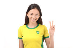 Girl signing victory for Brazil. Stock Images
