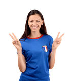 Girl signing victory for France. Stock Photos