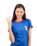 Girl signing victory for France. Royalty Free Stock Photos