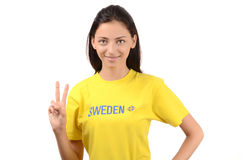 Girl signing victory for Sweden. Stock Photography