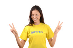 Girl signing victory for Sweden. Royalty Free Stock Photos