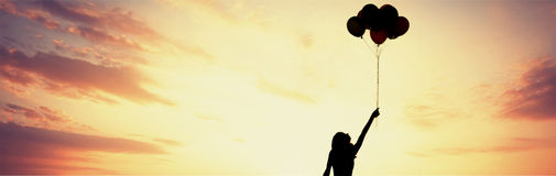 Girl silhouette with balloons Royalty Free Stock Image