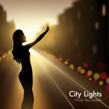 Girl Silhouette In City Lights Royalty Free Stock Photos