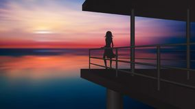 Girl silhouette enjoying the sunset from a balcony above the water stock photography