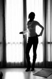 Girl Silhouette. Silhouette of a girl in front of a window Royalty Free Stock Photography